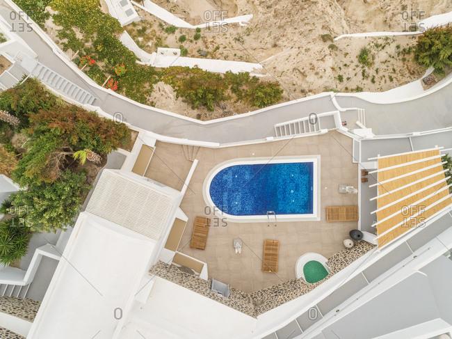 Aerial view of pool in residence on Santorini island, Mesaria Greece.