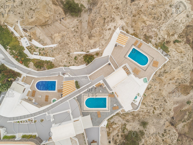 Aerial view of three pools in residence on Santorini island, Mesaria Greece.