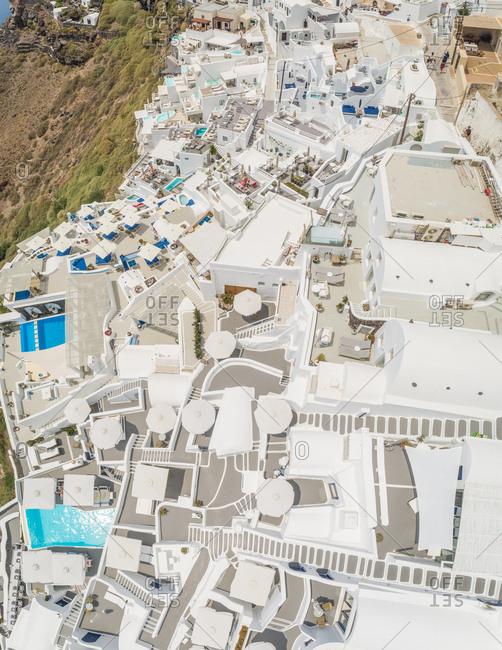 Aerial view above resort with pool on Santorini island, Imerovigli, Greece.