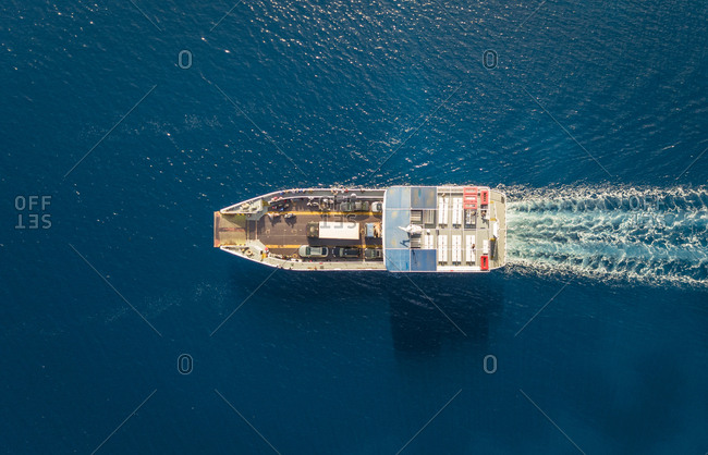 Aerial view of ferry boat with cars in the mediterranean sea, Kosta, Greece.