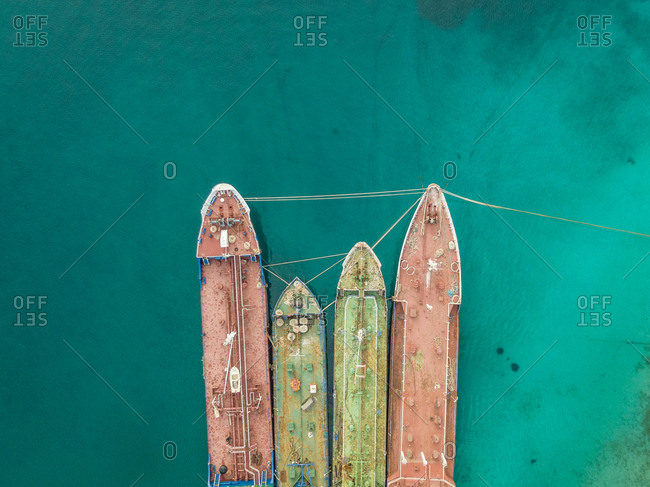 Aerial view of old cargo ships anchored in the mediterranean sea, Nisi, Greece.