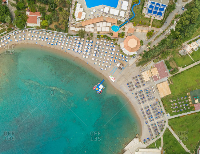 Aerial view of beach resort with white parasols, Rhodes island, Greece.