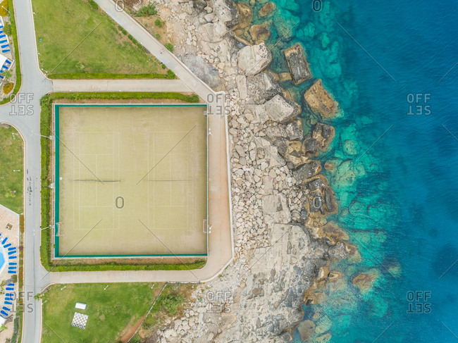 Aerial view of tennis court on seaside on Rhodes island, Greece.