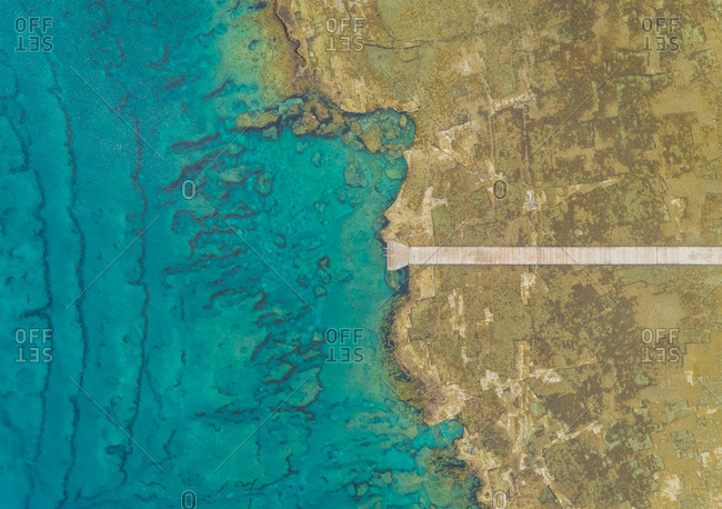 Aerial view of wooden pier on shore of Rhodes island, Greece.