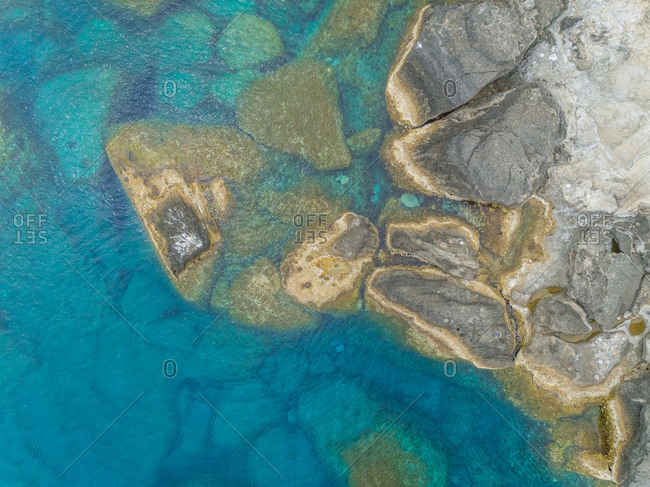 Aerial view of rock formation on shore of Rhodes island, Greece.