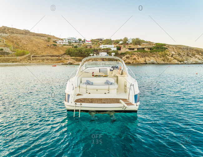 Close aerial view of luxurious yacht with catering, Mikonos island, Greece.
