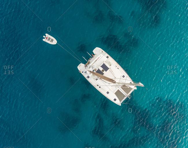 Aerial view of luxurious catamaran in the mediterranean sea, Mikonos island, Greece.