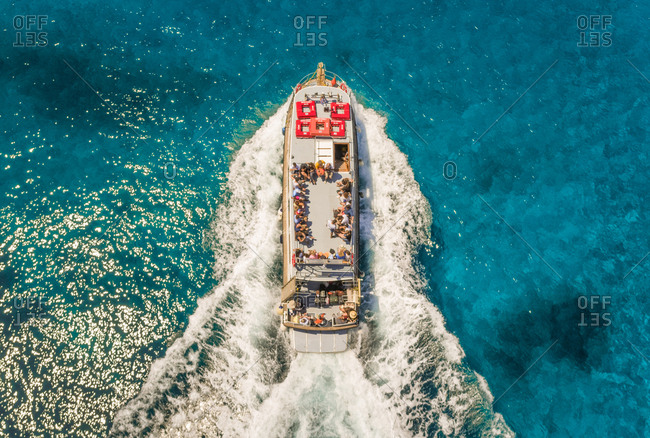 Aerial view of excursion boat in the mediterranean sea, Kosta, Greece.