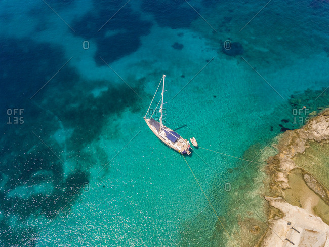Aerial view of sailboat anchored in the mediterranean sea, Nisi, Greece.