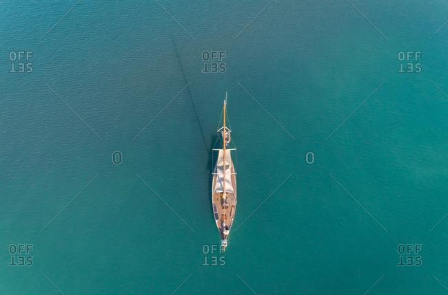 Aerial view of luxury sailboat in the mediterranean sea, Kefkada, Greece.