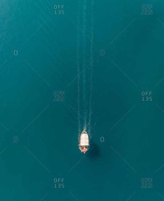 Aerial view of a small motorboat speeding on the mediterranean sea, Vathi, Greece.