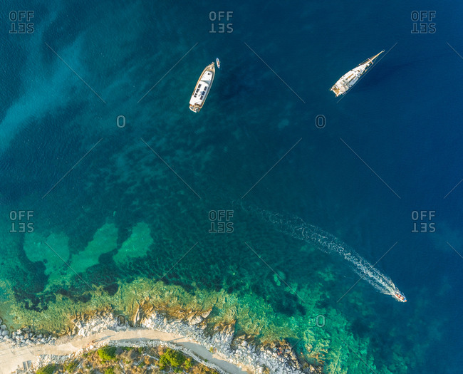 Aerial view of boats anchored next to Kastos island, Greece.