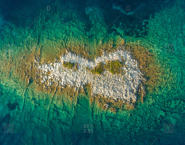 Aerial view of isolated islet, Greece.