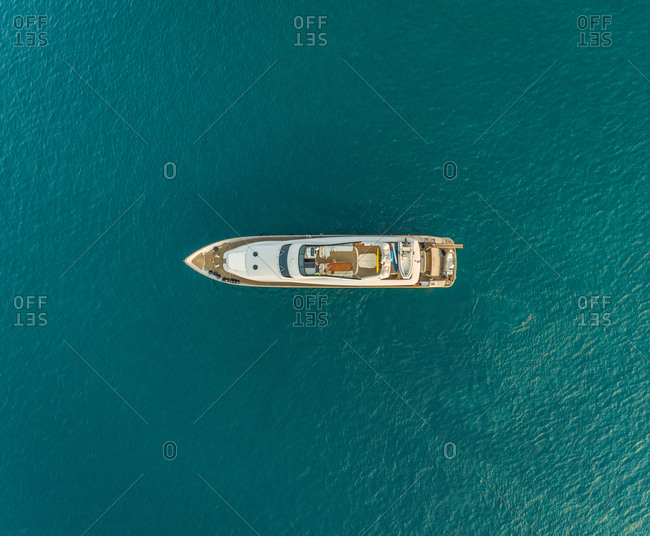 Aerial view of luxury boat in the mediterranean sea, Vathy, Greece.