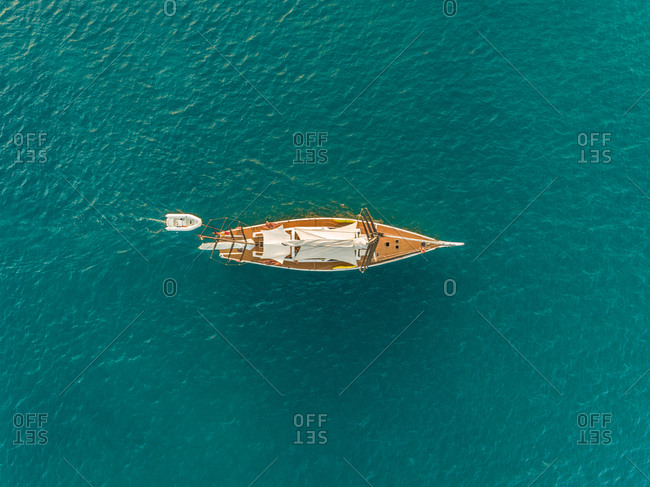 Aerial view of traditional sailboat in the mediterranean sea, Vathy, Greece.