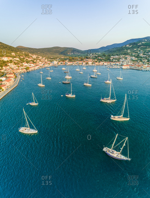 Aerial view of group of boats anchored in the bay of Ithaki, Greece.