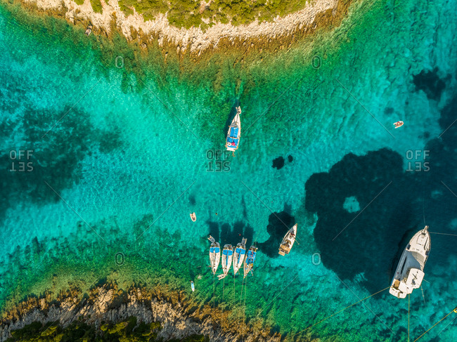 Aerial view of group of boats anchored between islands, Ithaki, Greece.