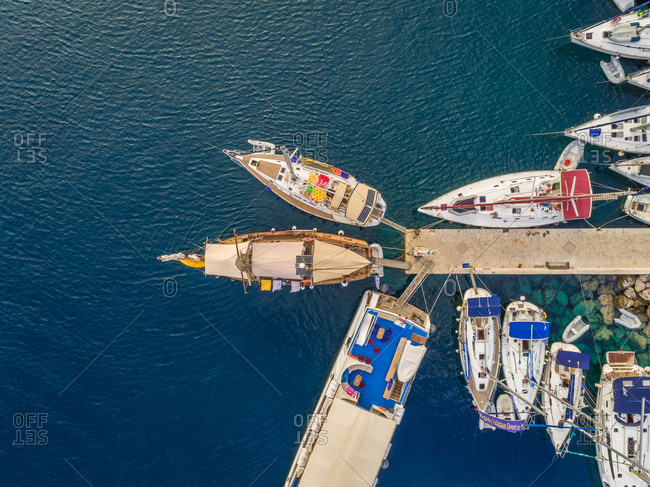Aerial view of boats anchored in harbor on Ionian island , Greece.