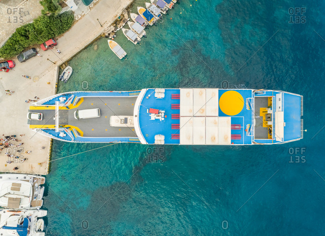 Aerial view of ferry anchored on harbor in Fiskardo, Greece.