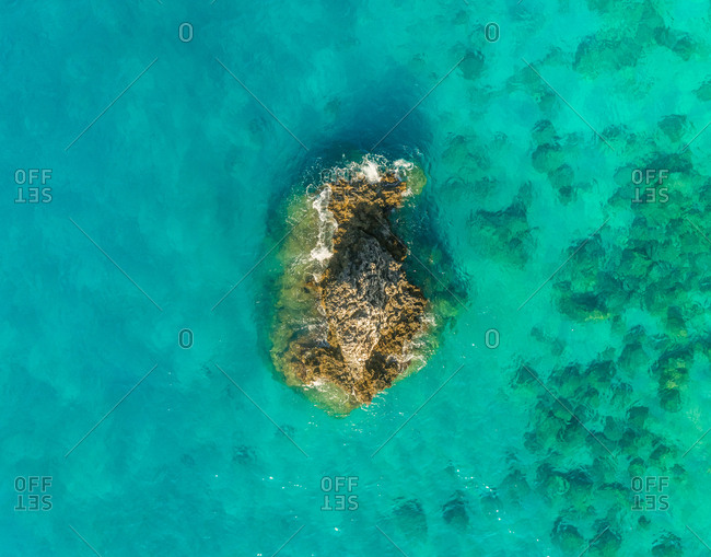 Aerial view of isolated rock formation next to Lefkada, Greece.