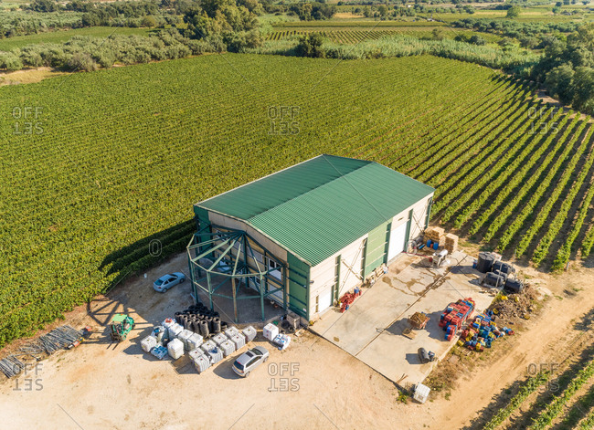 Aerial view of storage house next to vineyard, Greece.