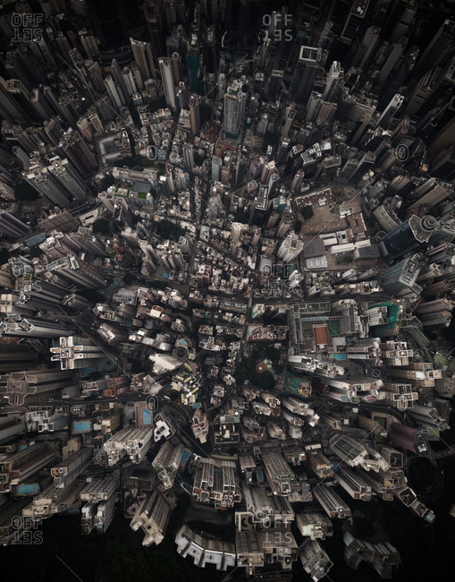 Moody aerial view of downtown buildings in business disctrict in Hong Kong, China.