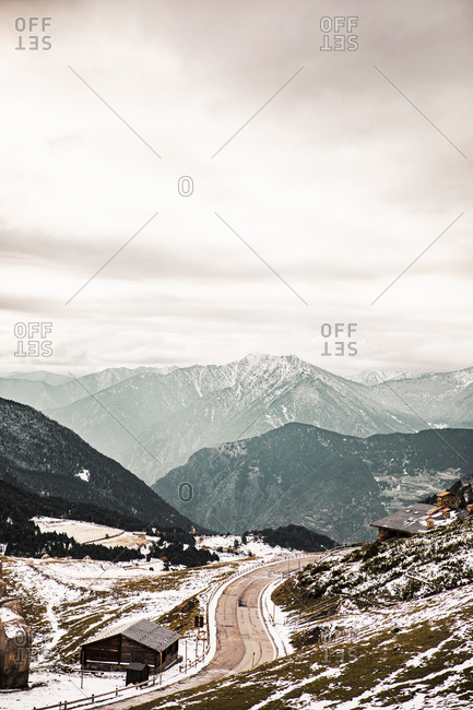 Road and snowy mountains in late fall
