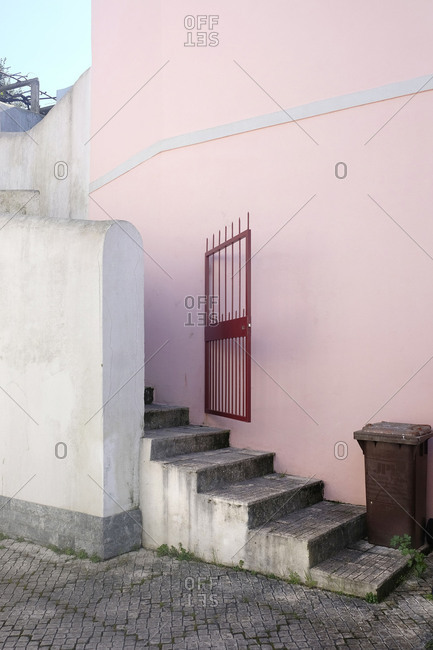 Portugal, pink house, open gate, stairs, garbage can