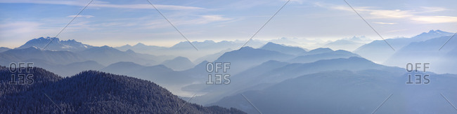 Alpine panorama shortly after sunrise, the morning mist in the valleys, mountain peaks: left the Benediktenwand, below a part of Lake Walchensee, on the far right the Schafreuter