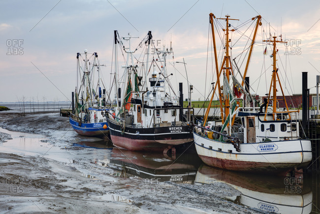 June 11, 2017: Cutter harbour, low tide, cloud mood, Wremen, district Cuxhaven, Lower Saxony, Germany, Europe