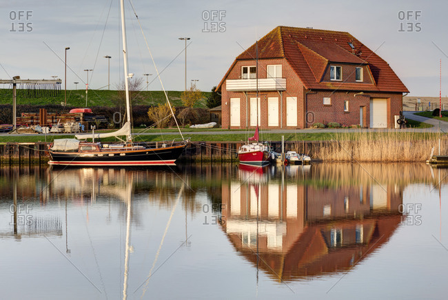 March 30, 2017: Boats at the old pump station, sluice, marina, Harlesiel, East Frisia, Lower Saxony, Germany,