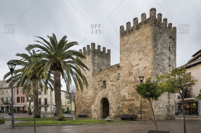 February 28, 2018: Medieval city gate in Alcudia, Mallorca, Balearic Islands, Spain