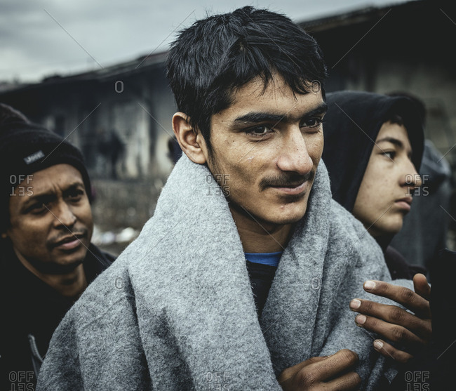 February 2, 2017: Warehouse complex in Belgrade, Serbia. In march, the numbers of refugees, mainly from Afghanistan and Pakistan is rising. More and more children and juveniles are arriving. Volunteers from different countries are organizing projects in and around the warehouse complex, providing food and clothes and firewood and workshops. In the last months a proper infrastructure of solidarity has grown in this area in the heart of Belgrade. Refugees waiting in line for food.