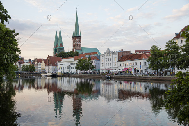 October 27, 2017: View of old town with St. Peter's Church and ship pier at the river Trave, Lubeck, Schleswig-Holstein, Germany