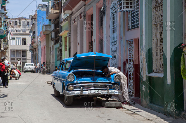 April 17, 2015: Vintage car at repair in old town, Havana, Cuba