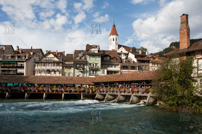 August 20, 2015: Bridge over the Aare and town church, old town, Thun on Lake Thun, Bernese Oberland, Switzerland