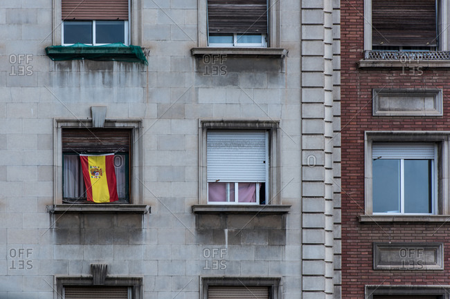 Spanish flag in front of a window in Barcelona