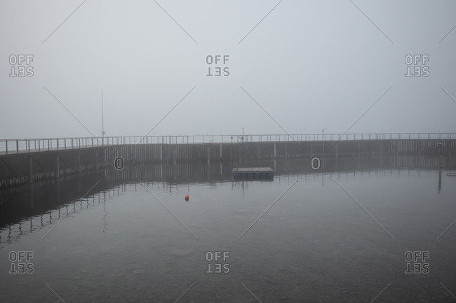 Marina surrounded by pier on a foggy day