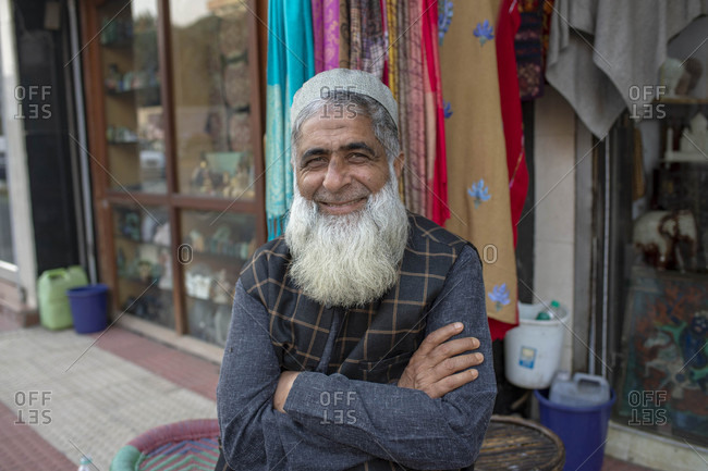 Delhi, India - December 4, 2018: Portrait of a smiling man with a gray beard