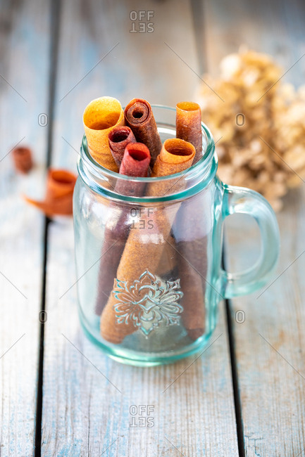 Delicious healthy fruit roll-ups made from raspberry, pumpkin and apples in glass beaker