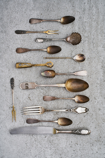 Vintage silverware on gray background