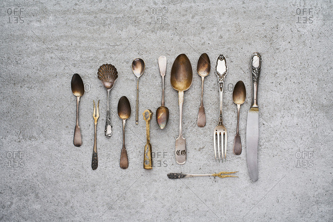 Vintage silverware on concrete background