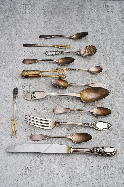 Antique silverware on gray background