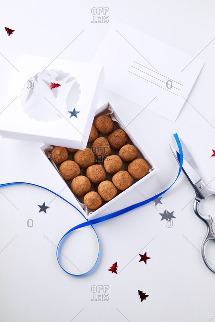 Chocolate truffles coated in cocoa powder in gift box