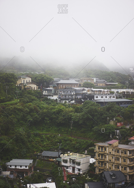 Taiwan, China - November 8, 2017: Buildings and houses on the side of a green and lush hillside looking from Chuen Ji Hall viewpoint