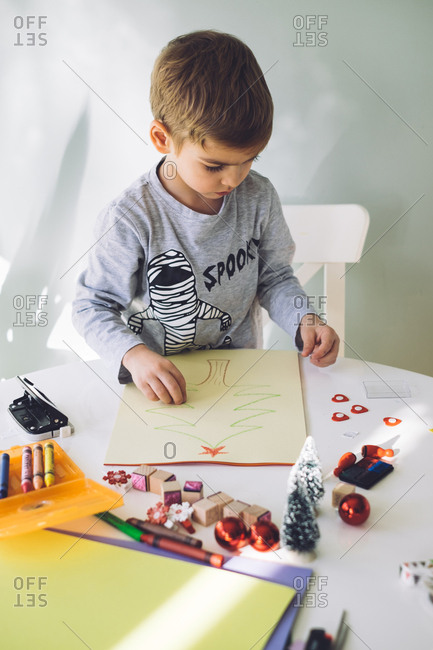Boy making a Christmas craft