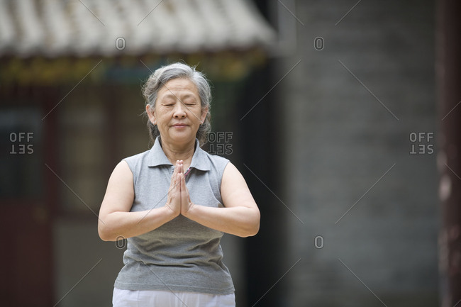 Senior woman practicing yoga.