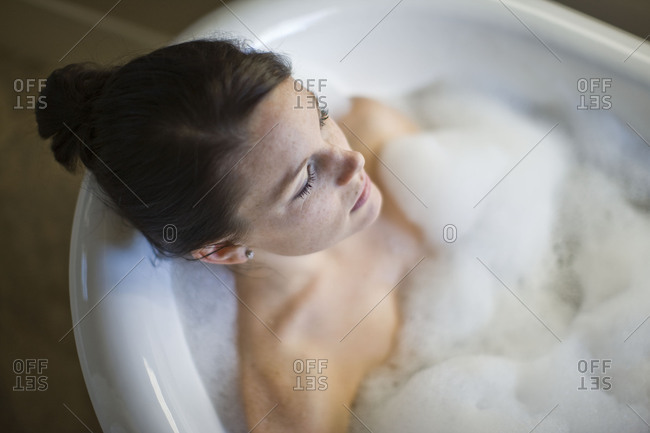 Woman enjoying relaxing bubble bath