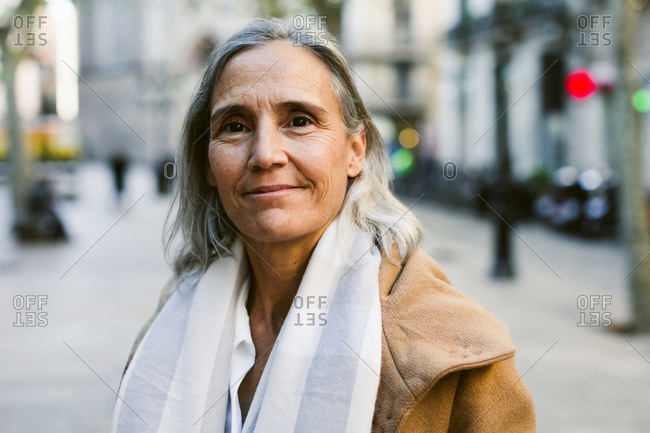 Portrait of a senior woman on the street in winter.