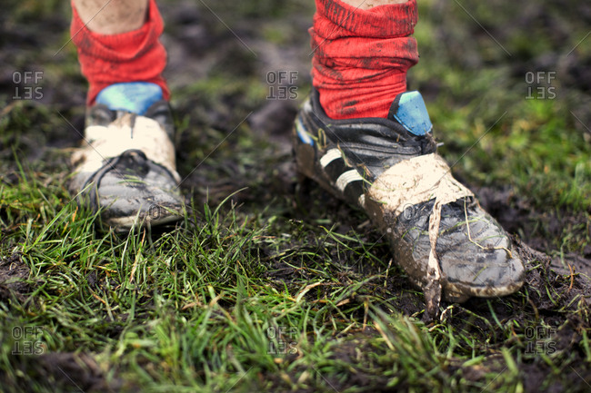 Close-up of rugby player's muddy shoes.